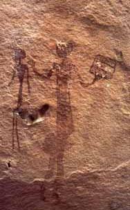 Наскальное изображение людей с сотами